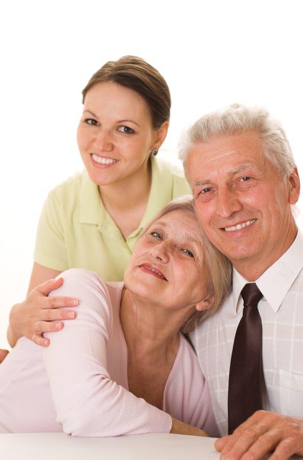 Bejaarden met een dochter royalty-vrije stock afbeelding