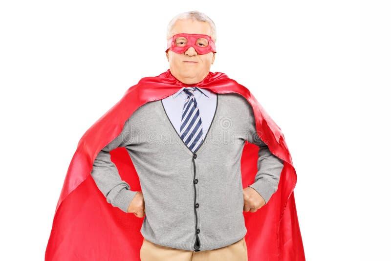 Bejaarden in superherokostuum royalty-vrije stock afbeeldingen