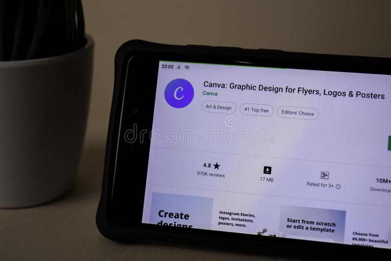Canva: Graphic Design dev application on Smartphone screen. Flyers, Logos, Posters royalty free stock photography