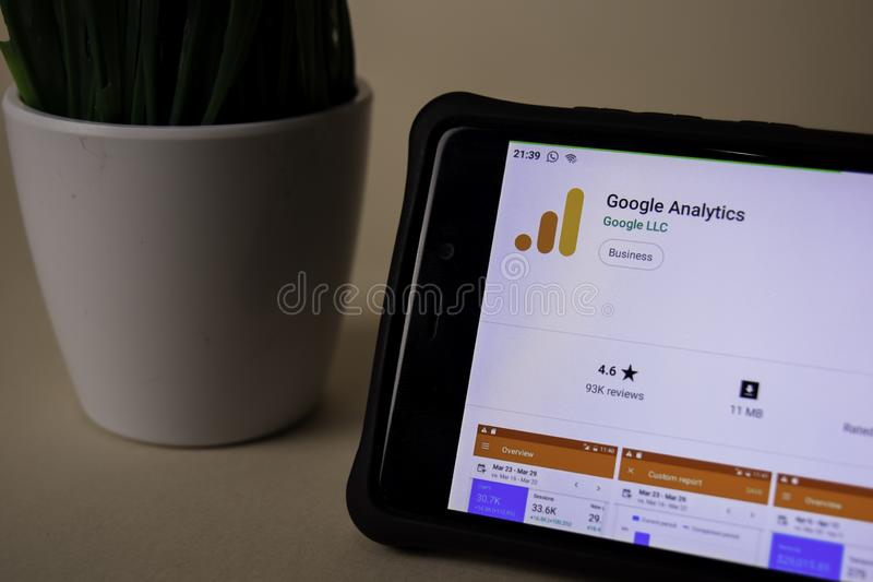 Google analytics dev application on Smartphone screen. analytics is a freeware web stock photography