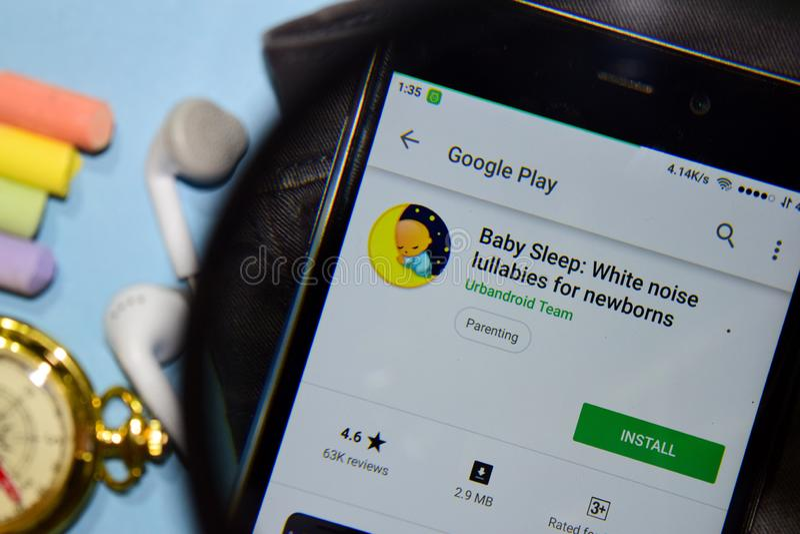 Baby Sleep: White noise lullabies for newborns dev app with magnifying on Smartphone screen. BEKASI, WEST JAVA, INDONESIA. DECEMBER 25, 2018 : Baby Sleep: White royalty free stock images