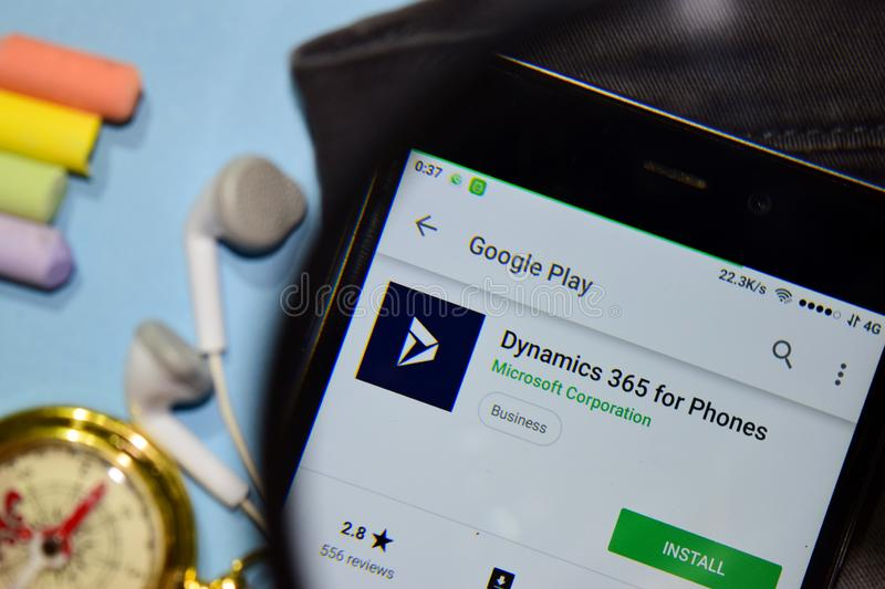 Dynamics 365 for Phones dev app with magnifying on Smartphone screen. BEKASI, WEST JAVA, INDONESIA. DECEMBER 17, 2018 : Dynamics 365 for Phones dev app with stock photos