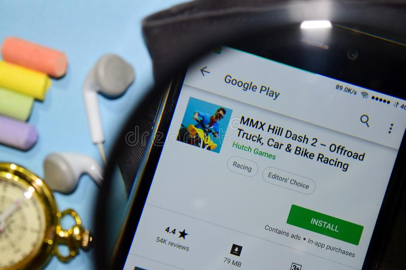 MMX Hill Dash 2 - Offroad Truck, Car & Bike Racing dev app with magnifying on Smartphone screen. BEKASI, WEST JAVA, INDONESIA. DECEMBER 25, 2018 : MMX Hill Dash royalty free stock photos