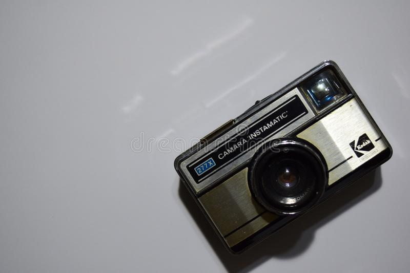 Old film camera. White background close-up. Vintage photo royalty free stock photo