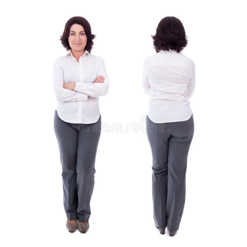 Bekläda och dra tillbaka sikten av kvinnan för den mogna affären som isoleras på vit royaltyfria foton