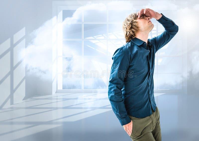 Beklemtoond mens die voor venster wordt teleurgesteld stock afbeelding