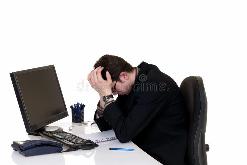 Beklemtoond zakenmanbureau stock foto's