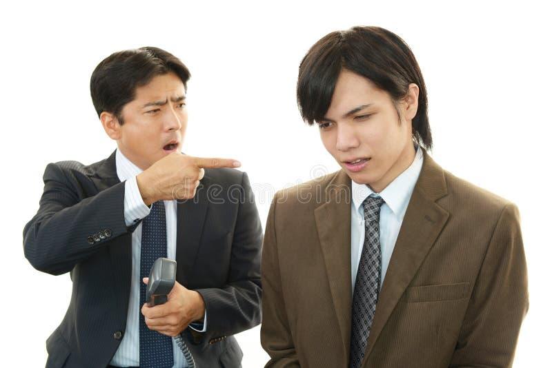 Beklemtoonde Aziatische zakenlieden stock afbeelding