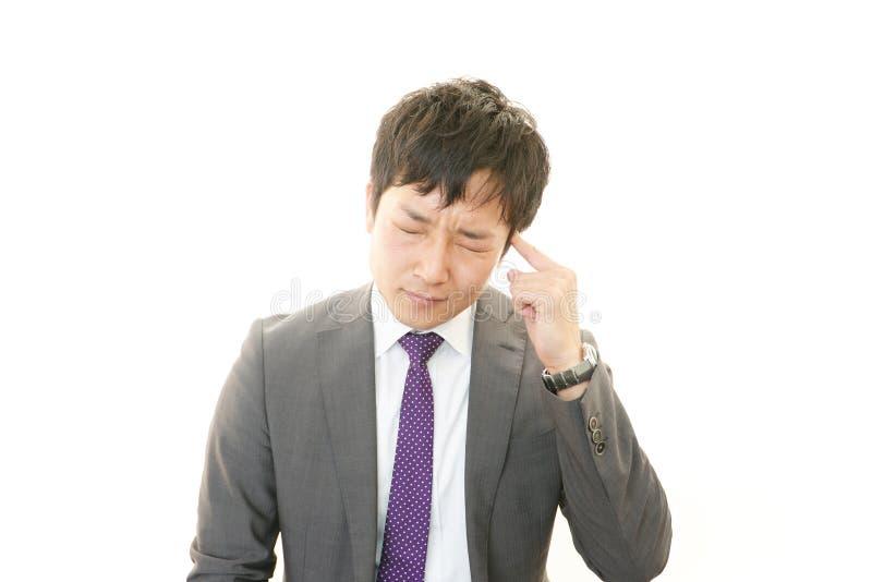 Beklemtoonde Aziatische zakenman royalty-vrije stock fotografie