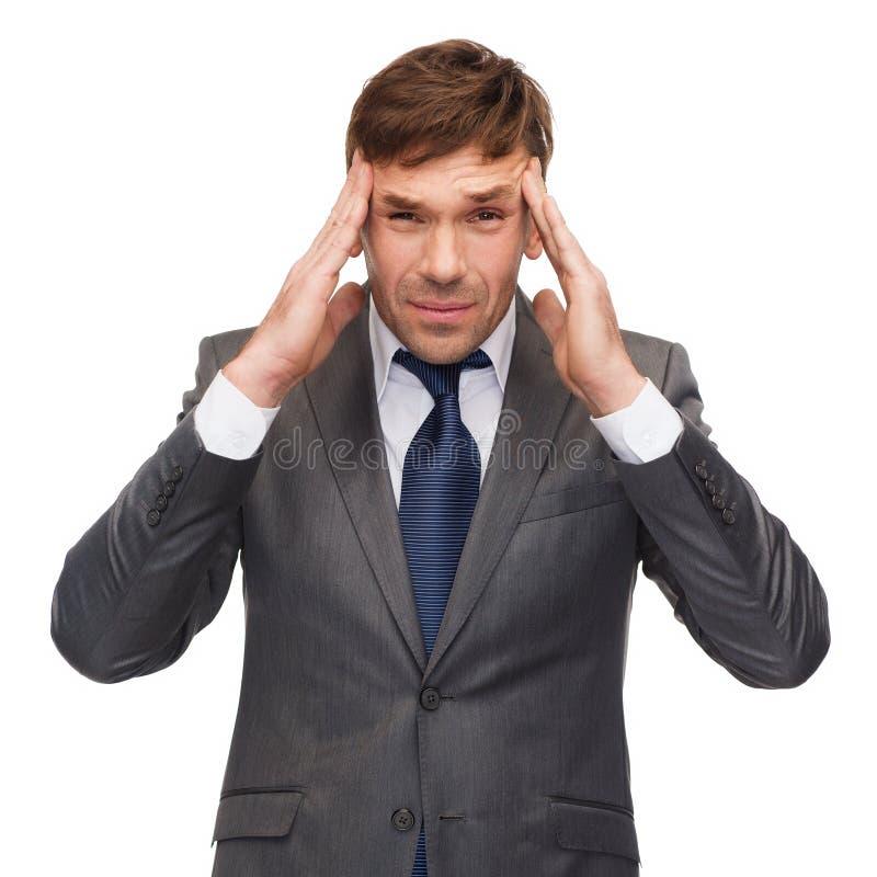 Beklemtoonde buisnessman of leraar die hoofdpijn hebben royalty-vrije stock afbeelding