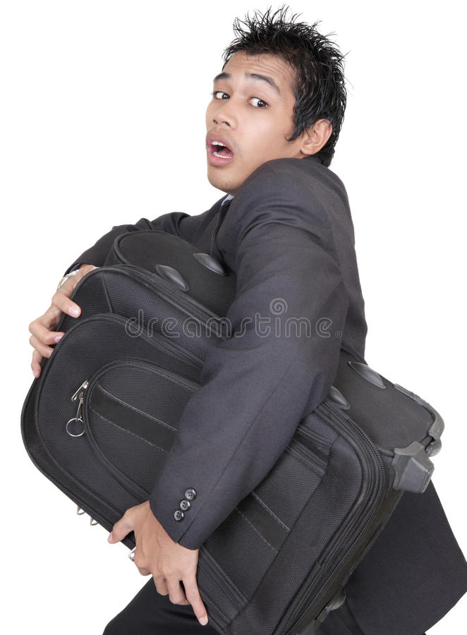 Beklemtoonde zakenman die wbagage in werking stelt stock fotografie