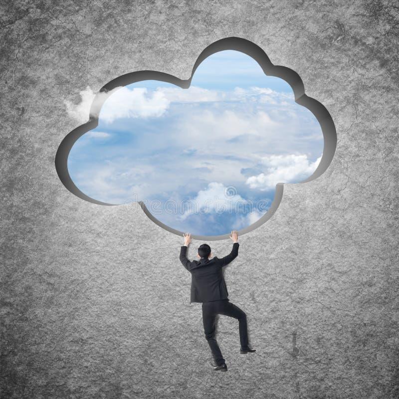 Beklim aan de wolk stock afbeeldingen