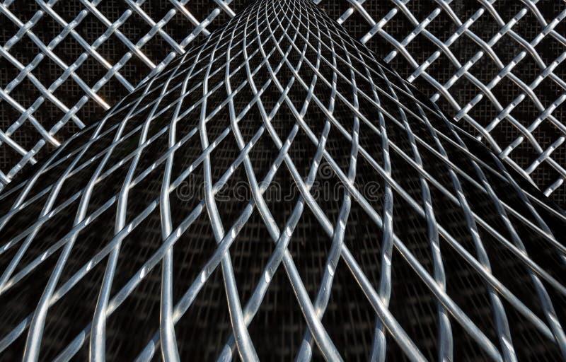 Belägga med metall ingrepps- eller aluminiumrastret på svart bakgrund fotografering för bildbyråer