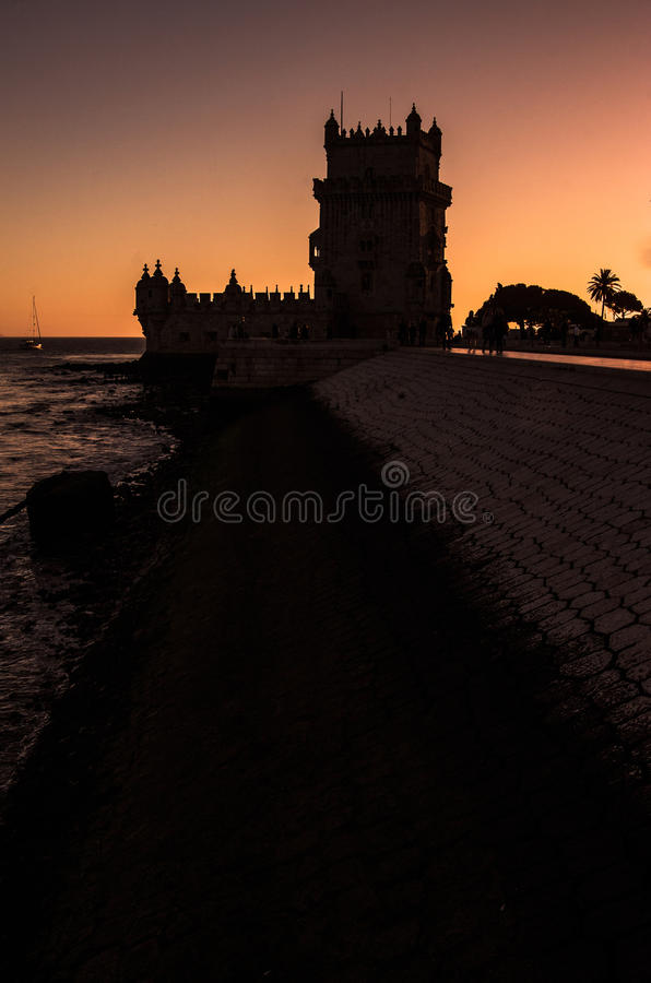 Belém. Belem building in Portugal, brick tower in the sunset. Vertical shot. Silhouette stock image