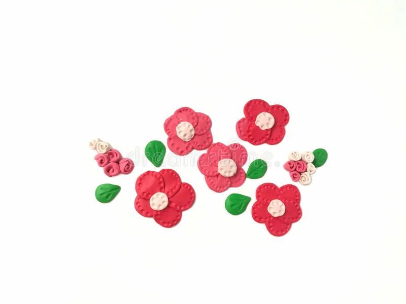 Bel argile rouge de pâte à modeler de fleur, pâte mignonne de forme images libres de droits