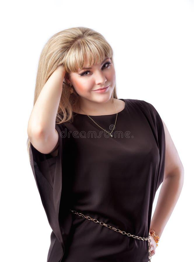 Bel aspect blond d'Européenne de fille Fond blanc d'isolement photographie stock