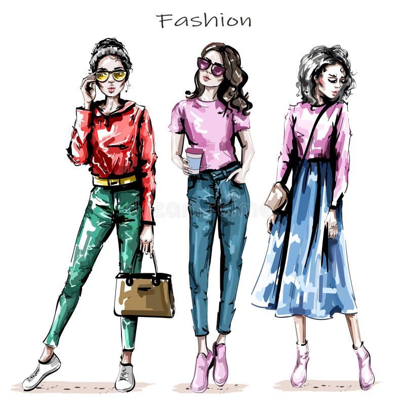Bel ensemble tiré par la main de jeunes femmes Filles élégantes Les femmes de mode regarde croquis illustration stock