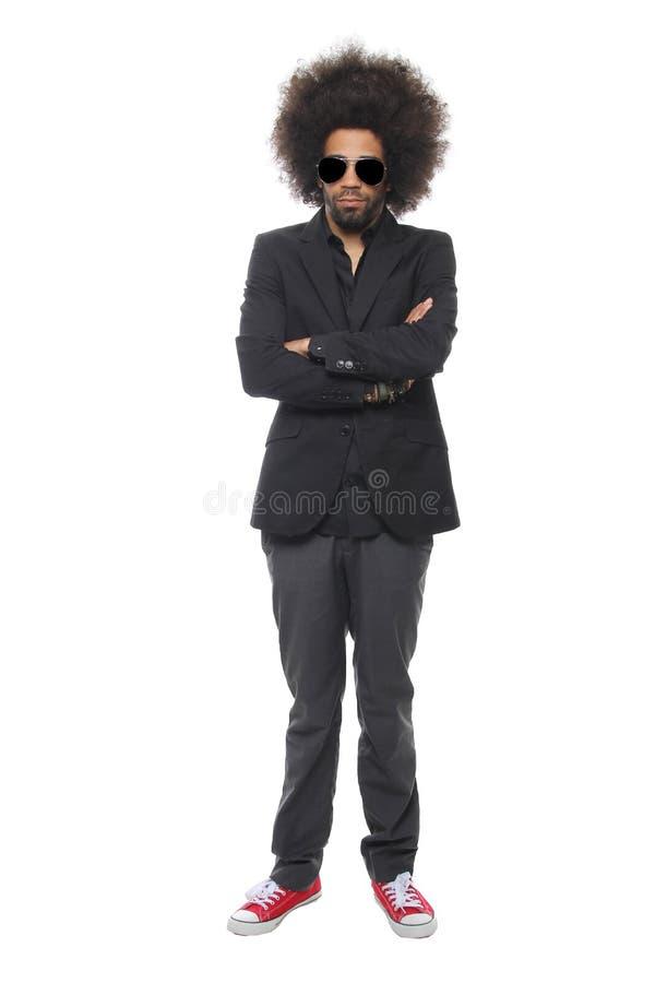 Bel homme devant un fond blanc faisant des expressions photos stock