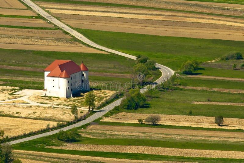Bela castle in Zagorje, Croatia. Bela castle in agricultural landscape of Zagorje, Croatia royalty free stock image