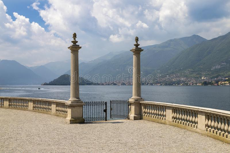 BELAGGIO, ITALY - MAY 10, 2015: The promenade of Villa Melzi on the lake Lago di Como royalty free stock photography