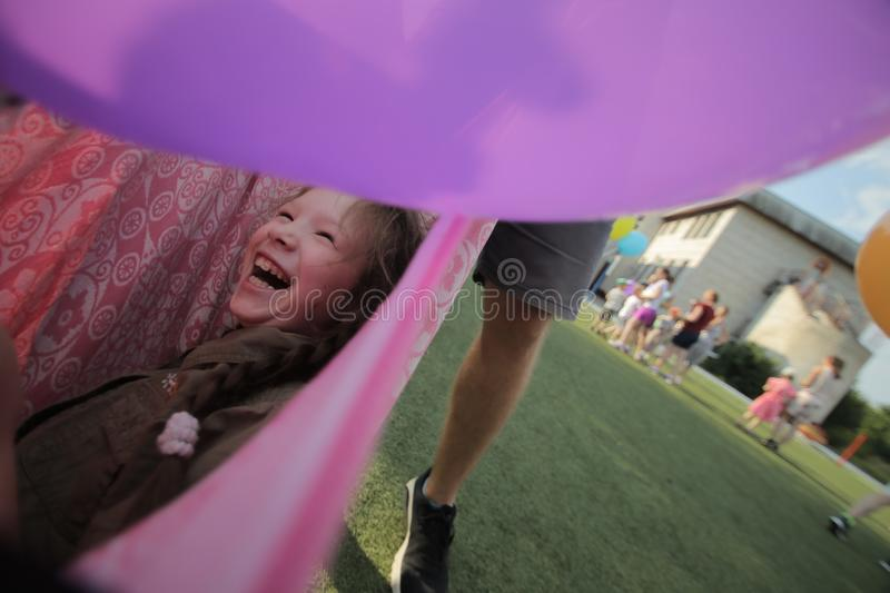 Belarus, Bobruisk - june 20, 2018: Cute little girl playing in blanket stock image