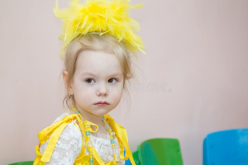 Kindergarten for children. Children`s holiday.Portrait of a three year old girl with stock image