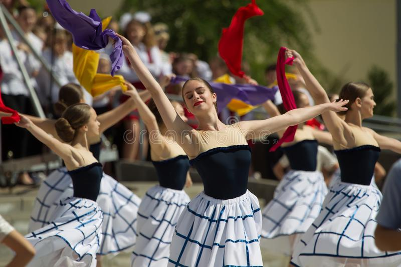 Holiday Victory Day. Central Park.Beautiful girls dancing on the street with scarves stock photo