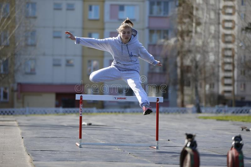 Jump over the barrier royalty free stock photography