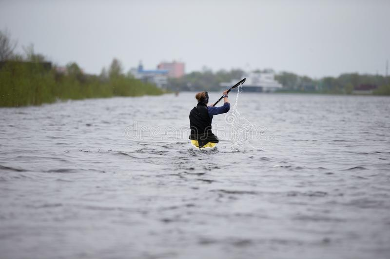 Training in rowing. A woman is on canoe. Belarus, Gomel, 25 April 2018. Training in rowing. A woman is on canoe stock photos