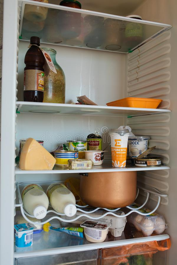 Belarus Minsk 06 12 2019 Front view of refrigerator full of food staying at home royalty free stock image