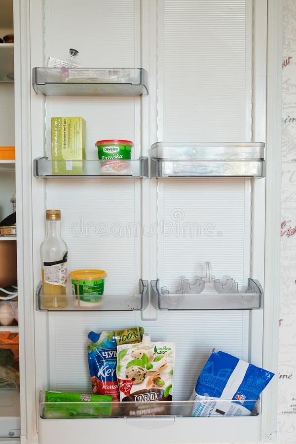 Belarus Minsk 06 12 2019 Front view of refrigerator full of food staying at home royalty free stock photo