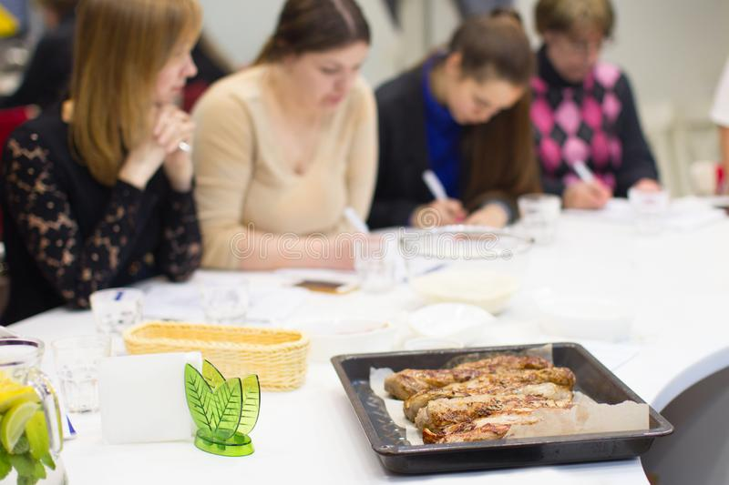 Belarus, Minsk, March 21, 2017. Culinary school. An open lesson on French cooking.People in the master class for cooking. Learn to stock photography