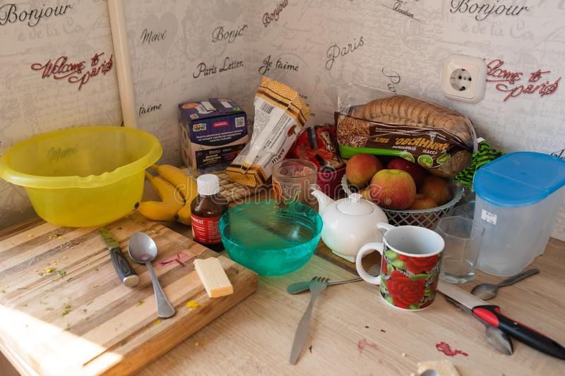 Belarus Minsk 06 12 2019 A messy dining table with food and utensils. royalty free stock photography