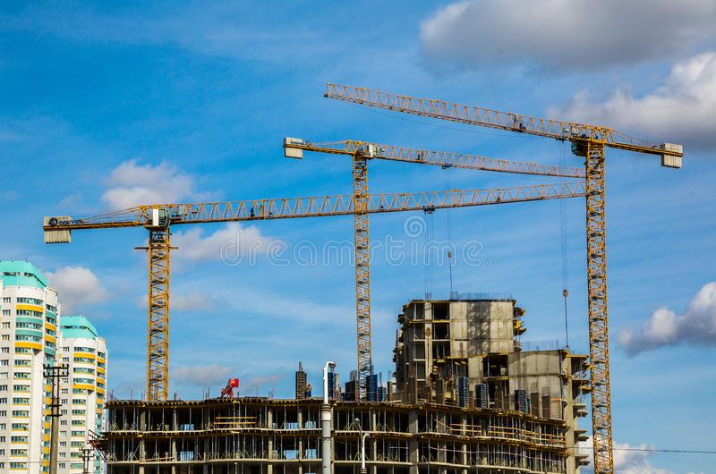 Minsk, civil engineering. Belarus, Minsk, 09/30/2018; Modern civil engineering, industrial tower cranes against a blue sky; Modern city landscape, editorial stock photo