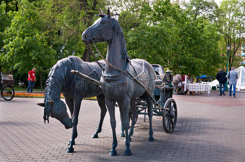 Belarus. Minsk. Monument Crew. Two horses with a cart. May 21, 2017. Belarus. Minsk. Monument Crew. Two horses with a cart. Sculpture of Vladimir Zhbanov. May 21 stock image
