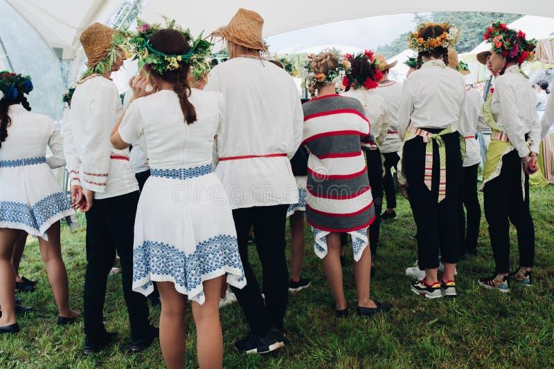 Belarus Minsk 26 07 2019 People in floral wreath at festival. stock image
