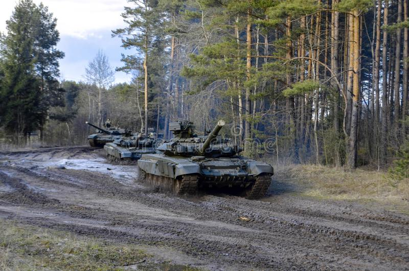 Russian battle tanks on the exercises in the forest area stock image