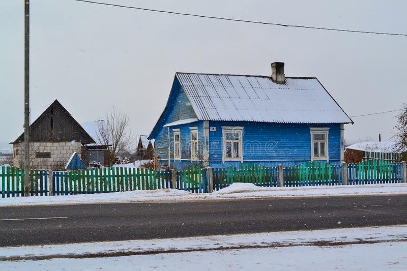 Belarus. Russian village on snowy background. Rustic wooden wall texture. Country architecture stock images