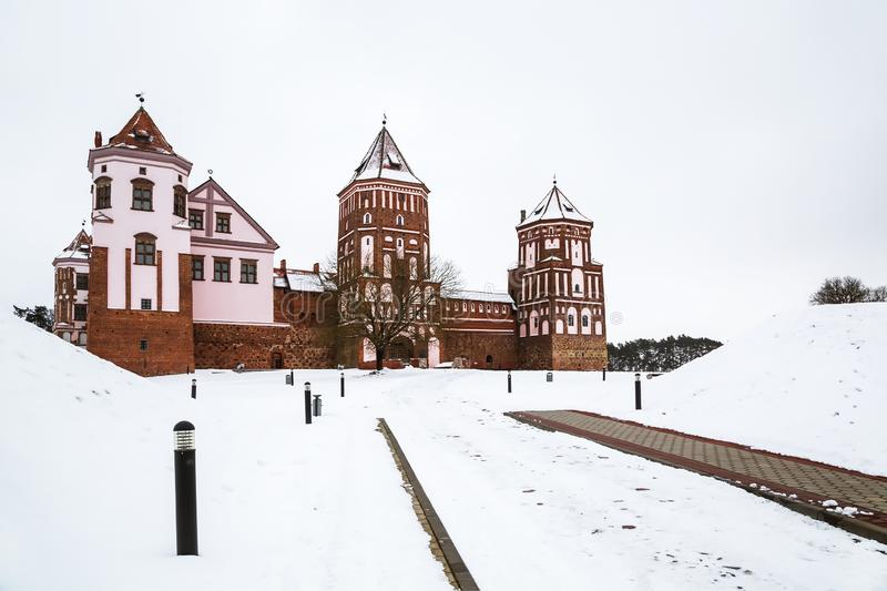 The Mir Castle. winter. Belarusian attraction Mir Castle covered with snow in the winter season royalty free stock photos