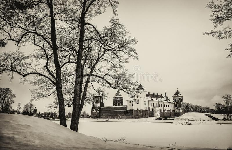 The Mir Castle. winter. Belarusian attraction Mir Castle covered with snow in the winter season. retro style royalty free stock photography