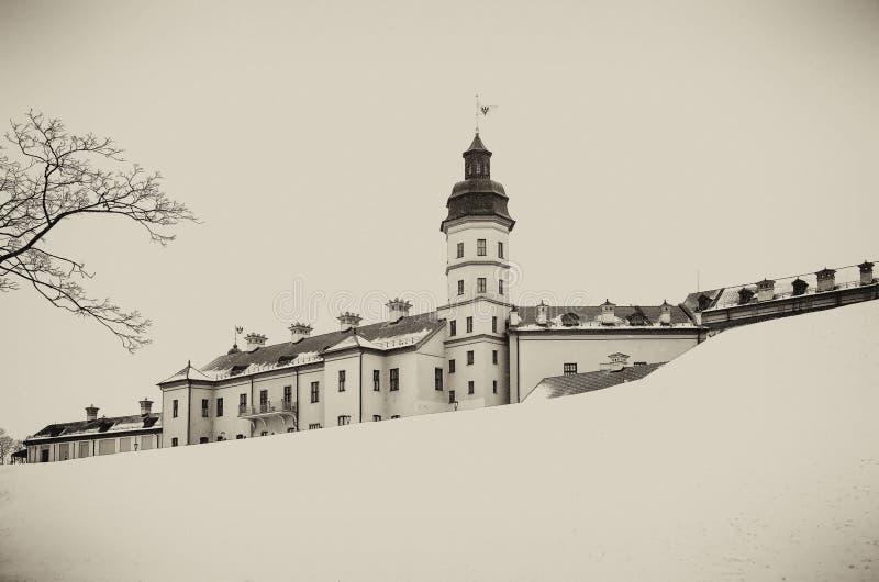 Nesvizh Castle. winter. Belarusian attraction Nesvizh castle covered with snow in the winter season. retro style stock image