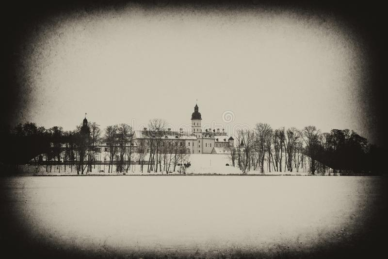 Nesvizh Castle. winter. Belarusian attraction Nesvizh castle covered with snow in the winter season. retro style royalty free stock images