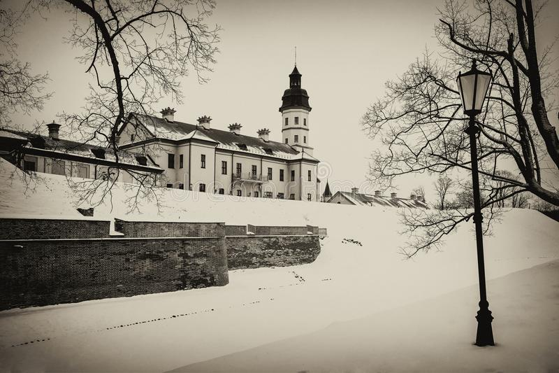 Nesvizh Castle. winter. Belarusian attraction Nesvizh castle covered with snow in the winter season. retro style royalty free stock image