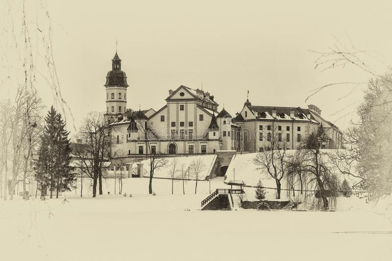 Nesvizh Castle. winter. Belarusian attraction Nesvizh castle covered with snow in the winter season. retro style royalty free stock photography