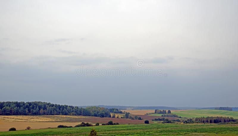 The Belarusian landscape. Autumn fields, forests, bushes, meadows, trees, hills. The Belarusian landscape. It`s a warm autumn day royalty free stock images