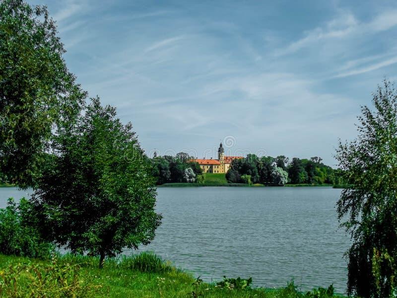 Belarusian Nesvizh Castle - medieval castle. And beautiful landscape stock image