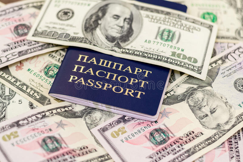 Belarusian passport and banknotes with wood deck background royalty free stock photography