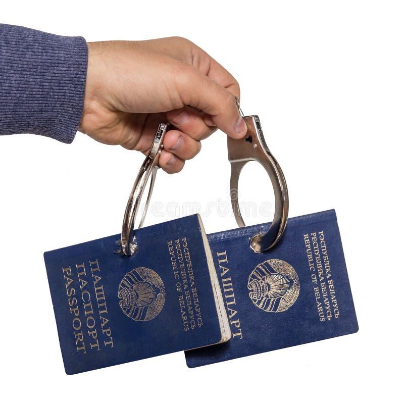 Belarusian passport in handcuffs royalty free stock image