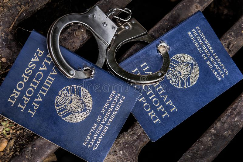 Belarusian passport in handcuffs royalty free stock photo