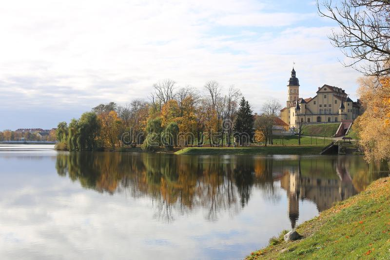 Belarusian tourist landmark attraction Nesvizh Castle - medieval castle in Nesvizh, Belarus reflection in water. beautiful autumn.  stock image